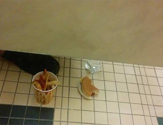 Only In America: Man Eating In Bathroom Stall
